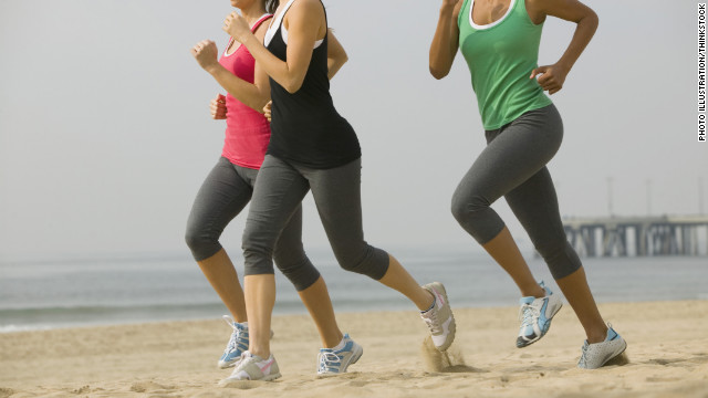 women run on the beach in california